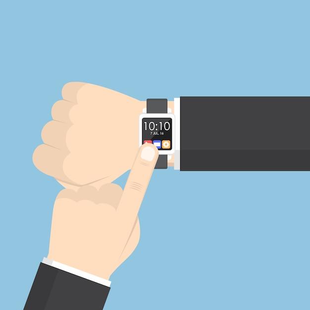 Zakenmanhand die smartwatch op zijn pols gebruiken Premium Vector
