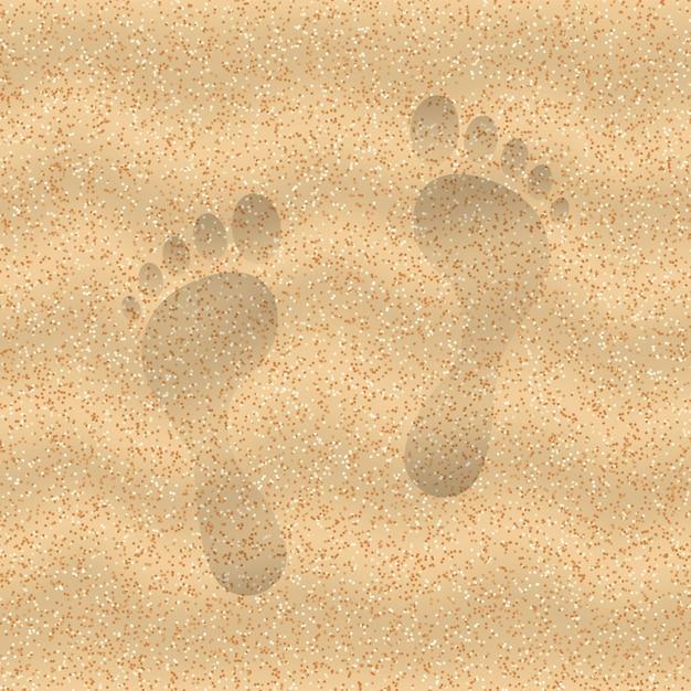 Zand van het strand met voetafdruk Premium Vector