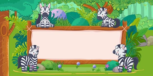 Zebra's met een leeg bord hout in de jungle Premium Vector