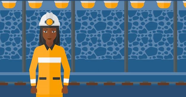 Zelfverzekerde mijnwerker in veiligheidshelm Premium Vector
