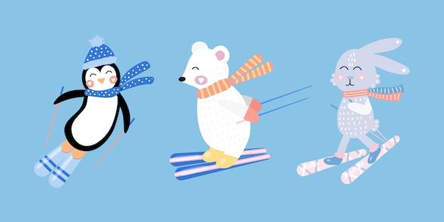 Zet schattige haas, witte beer, pinguïn op ski's. hand getekend. Premium Vector