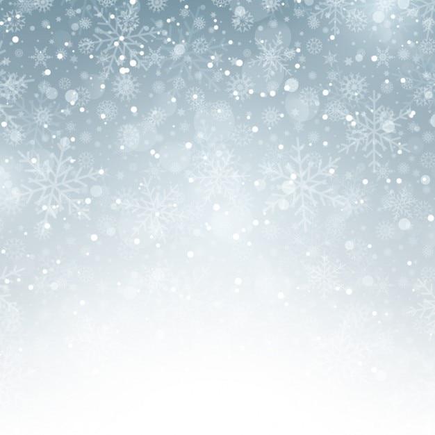 Zilveren achtergrond met sneeuwvlokken Gratis Vector