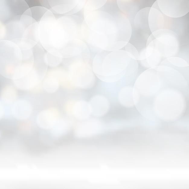 Zilveren bokeh licht achtergrond Gratis Vector