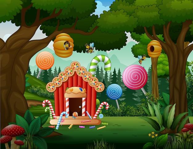 Zoet huis van snoep in het boslandschap Premium Vector