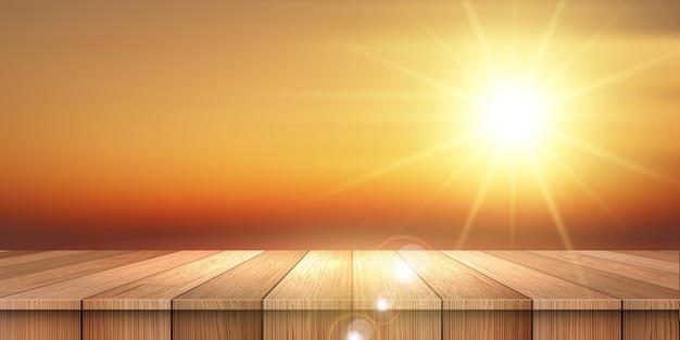 Zomer thema banner met houten tafel met uitzicht op een avondrood Gratis Vector