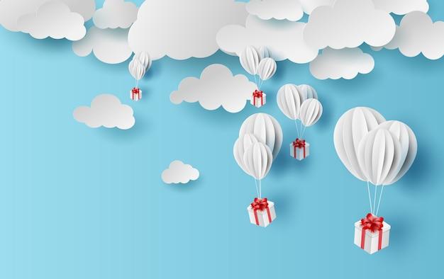 Zomertijd ballonnen geschenkdoos zweven. Premium Vector
