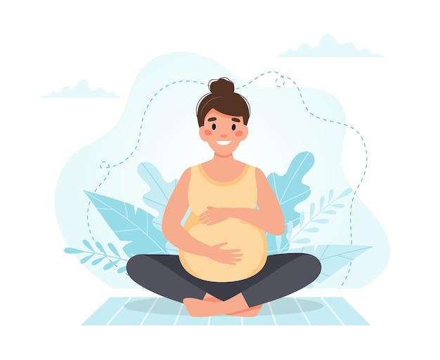Zwangere vrouw mediteert. Premium Vector