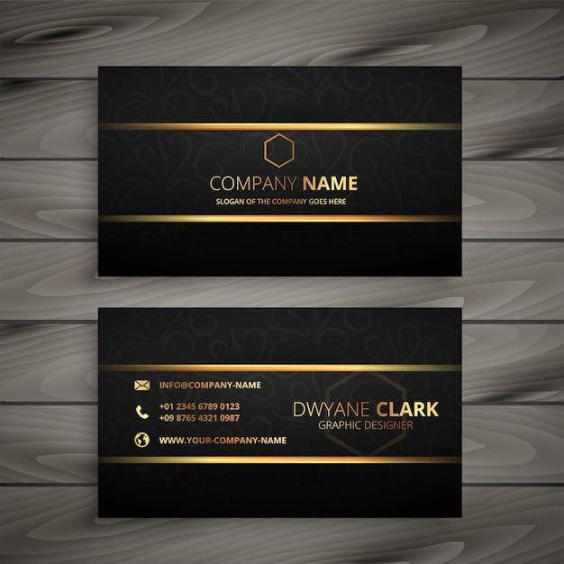 Zwart en gouden premium visitekaartje Gratis Vector