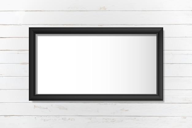 Zwart frame mockup op een muurvector Gratis Vector
