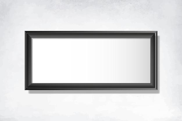 Zwart leeg frame op de muur Gratis Vector