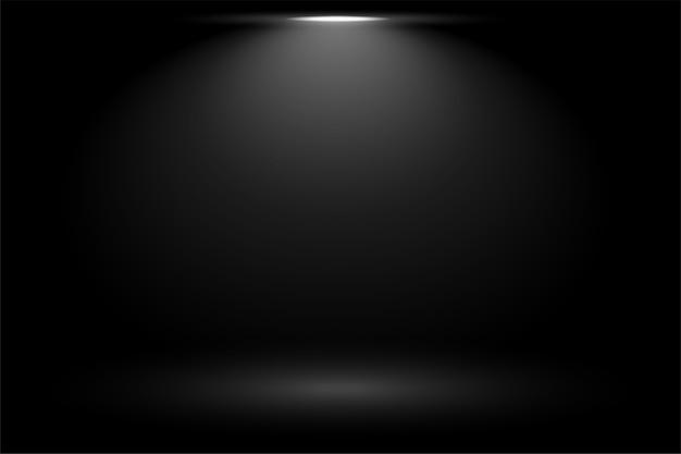 Zwarte achtergrond met het licht van de nadrukvlek Gratis Vector