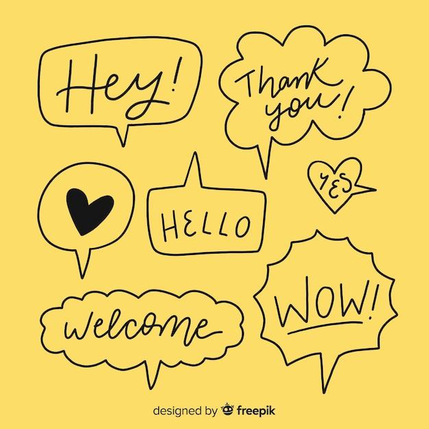 Zwarte hand getrokken tekstballonnen op geel Gratis Vector