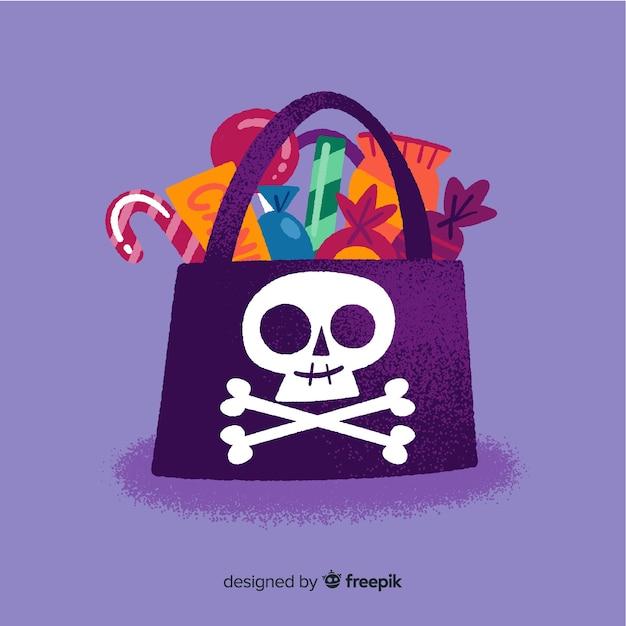 Zwarte piraat schat schedel tas met snoepjes Gratis Vector