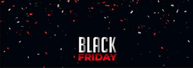 Zwarte vrijdag banner met rode en witte confetti Gratis Vector