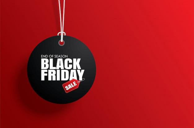 Zwarte vrijdag tag tag cirkel en het touw opknoping op rood Premium Vector