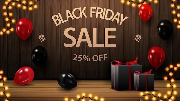 Zwarte vrijdag uitverkoop, tot 25% korting, kortingsbanner met houten wand, geschenken en ballonnen. Premium Vector