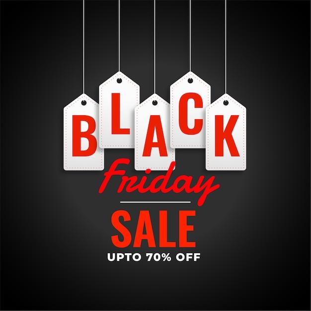 Zwarte vrijdag verkoop achtergrond met hangende tags Gratis Vector