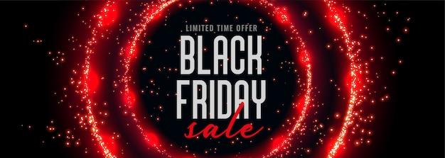 Zwarte vrijdag verkoop banner met rode cirkelvormige sparkles Gratis Vector