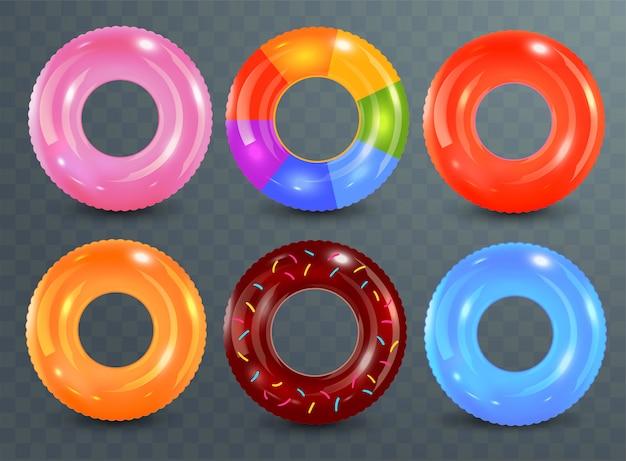 Zwemringen ingesteld op transparante achtergrond. onmogelijke rubberen speelgoed. reddingsboei kleurrijke collectie. zomer. realistische zomer illustratie. Premium Vector